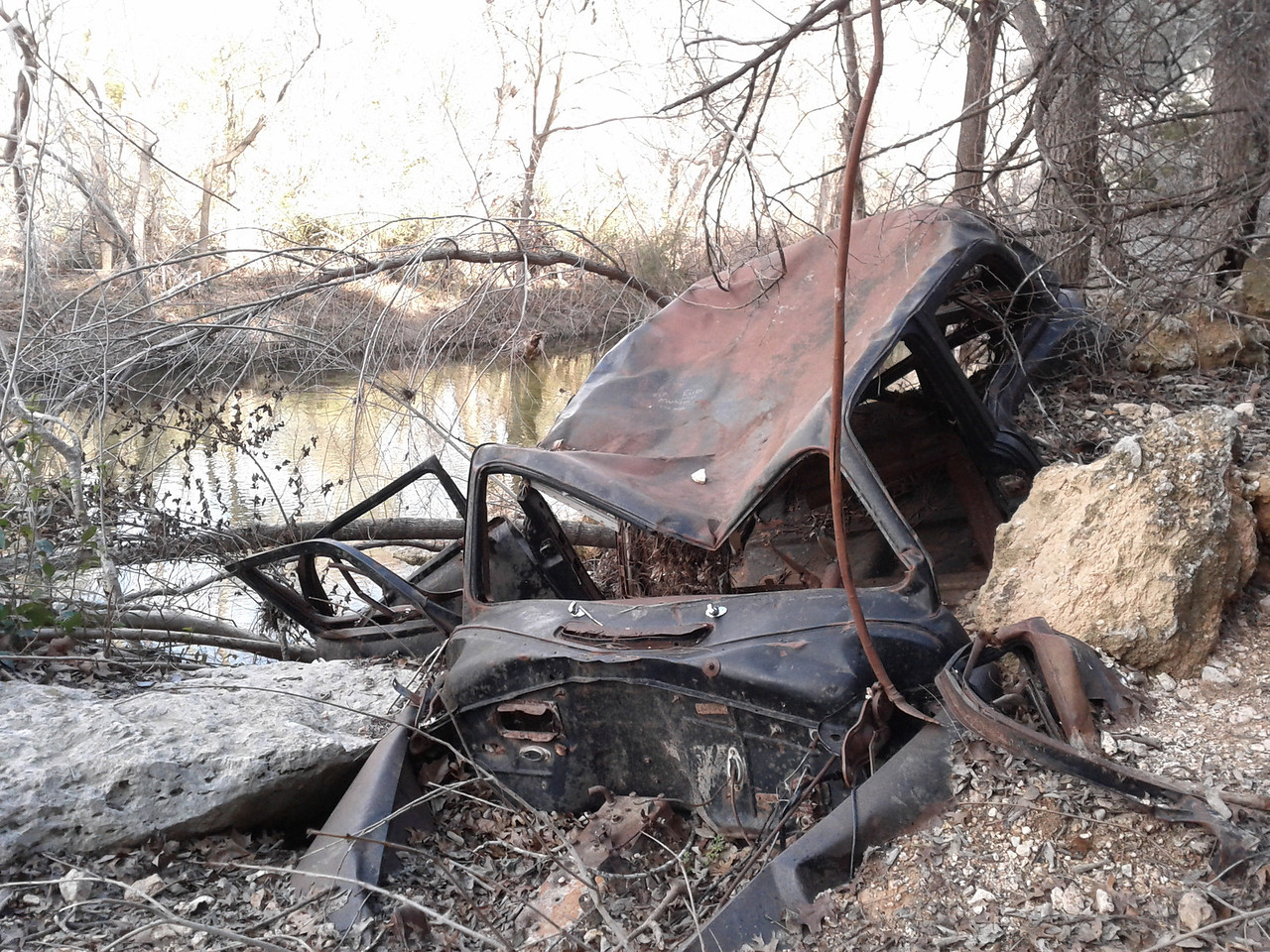 Wonder what's the story with this old wreck we found on Bull Creek?